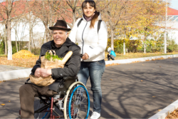 man on wheelchair with his assitant