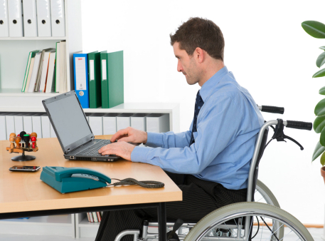 typing man on a wheelchair